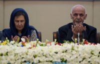 President Ashraf Ghani of Afghanistan, right, and the country's first lady, Rula Ghani, left, pray during the Kabul Process conference at the Afghan presidential palace on Feb. 28. Credit Shah Marai/Agence France-Presse — Getty Images