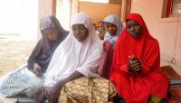 From left, Fatima Abdu, 14, Zahra Bukar, 13, Fatima Bukar, 13, and Yagana Mustapha, 15, four schoolgirls who escaped from a Boko Haram attack on their school, sit at the home of a schoolmate at Dapchi town in northern Nigeria on Feb. 28. (AFP/Getty Images)
