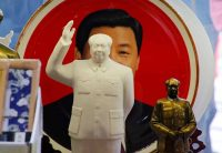 Jason Lee/Reuters Sculptures of Mao Zedong in front of a souvenir plate with a portrait of Chinese President Xi Jinping, Tiananmen Square, Beijing, March 1, 2018