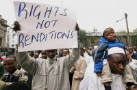 A Kenyan Muslim held up a sign during a protest against terrorism-related extraordinary renditions, Nairobi, Kenya, in 2007. Credit Khalil Senosi/Associated Press