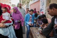 Volunteers help voters identify their polling stations in 2015 during the final day of the first round of parliamentary elections in Fayoum, Egypt. (Eman Helal/AP)
