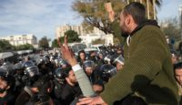 A Fesh Nestannaw protest in Tunis. Photo via Getty Images.