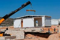 New mobile homes being installed in Amichai in February. Credit Ahmad Gharabli/Agence France-Presse — Getty Images