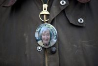 A pin with a portrait of Mireille Knoll, at a march in Paris on Wednesday in response to her murder.CreditGonzalo Fuentes/Reuters