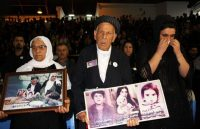 Iraqi Kurds hold pictures of deceased relatives as they gather in Halabja on March 16 to mark the 30th anniversary of the Halabja gas massacre that killed some 5,000 people. (SHWAN MOHAMMED/AFP via Getty Images)