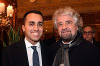 Luigi Di Maio, the Italian Five Star Movement's leader, poses with party founder Beppe Grillo, right, in Rome, on Monday, one day after the party won the highest share of votes in Sunday's elections. (Alessandro Di Meo/ANSA via AP)