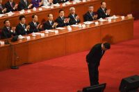 President Xi Jinping of China bowing to delegates before delivering a speech in Beijing this week. Credit Greg Baker/Agence France-Presse — Getty Images
