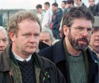 Martin McGuinness, the Sinn Fein chief negotiator, left, and Sinn Fein President Gerry Adams as they participate in the Bloody Sunday anniversary march in Londonderry, Northern Ireland, on Feb. 1, 1998. (AP)