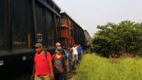 """Central American migrants walk close to the trains known as """"The Beast"""" in Tenosique, Tabasco, Mexico, in May 2016. CRISISGROUP/MarySpeck"""