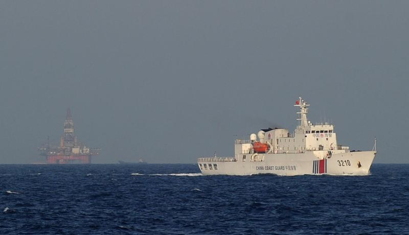 A Chinese coast guard vessel sails near an oil drilling rig in disputed waters in the South China Sea in 2014. Photo: Getty Images.