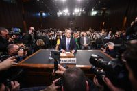 Facebook CEO Mark Zuckerberg arrives to testify before a joint hearing of the Senate Commerce and Judiciary committees on Capitol Hill on April 10 in Washington. (Jim Watson/AFP/Getty Images)
