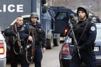 Kosovo police block a street last month in the northern, Serb-dominated part of Mitrovica, Kosovo. (Bojan Slavkovic/AP)