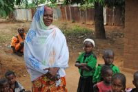 Nina Beina on the land she bought for her children, with the help of a loan from a microsavings group.CreditTyler Pager