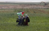 Palestinian women near the Israel-Gaza border on March 29, a day before the start of a six-week sit-in by Palestinians that turned deadly.CreditMohammed Salem/Reuters