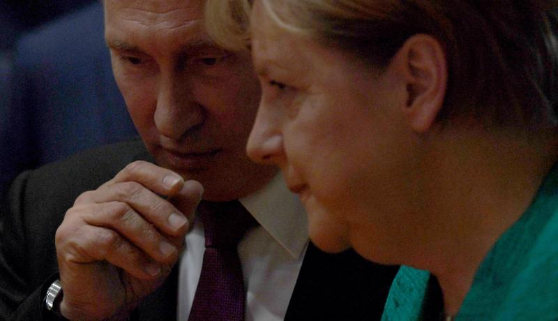 Vladimir Putin and Angela Merkel at the G20 summit in 2017. Photo: Getty Images.