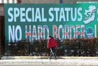 "A billboard in West Belfast, shown Dec. 8, was erected by the Sinn Fein party and calls for a special status for Northern Ireland with respect to Brexit and no ""hard border"" in Ireland. (Paul Faith/AFP/Getty Images)"