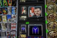 President Recep Tayyip Erdogan's portrait on a cigarette case and a lighter at an Istanbul souvenir shop.CreditOzan Kose/Agence France-Presse — Getty Images