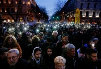 People marching against Prime Minister Viktor Orban flash the lights of their mobile phones in Budapest last month. Hungarians will vote Sunday in parliamentary elections, choosing 199 lawmakers. Polls say Orban should win a third consecutive term. (Darko Vojinovic/Associated Press)