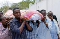 People carry the body of the journalist Abdisatar Dahir, who was killed in a double suicide attack in Mogadishu, Somalia, in 2012.CreditMohamed Abdiwahab/Agence France-Presse — Getty Images
