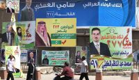 Campaign billboards in Baghdad in 2014. Photo: Getty Images.