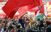"Supporters lift former Brazilian president Luiz Inacio ""Lula"" da Silva outside the Metal Workers Union headquarters in Sao Bernardo do Campo on April 7. (AP)"