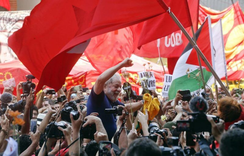 "Supporters lift former Brazilian president Luiz Inacio ""Lula"" da Silva outside the Metal Workers Union headquarters in Sao Bernardo do Campo on April 7. (AP)"