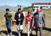 Nobel Peace Prize laureate Malala Yousafzai walks with her brother Atal Yousafzai, left, her father, Ziauddin Yousafzai, and the principal of all-boys Swat Cadet College, Guli Bagh, during a visit to her home town, Mingora, last month. (Abdul Majeed/AFP/Getty Images)