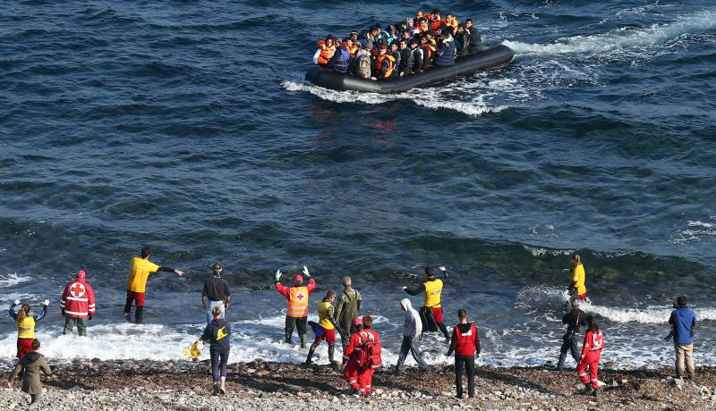 A boat carrying migrants approaches shore after making the crossing from Turkey to the Greek island of Lesbos in November 2015. Photo: Getty Images.