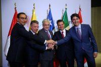 Los presidentes de Perú, Martín Vizcarra; Colombia, Juan Manuel Santos; Chile, Sebastián Piñera; México, Enrique Peña Nieto, y el primer ministro de Canadá, Justin Trudeau, en la VIII Cumbre de las Américas, el 14 de abril de 2018 Credit Reuters