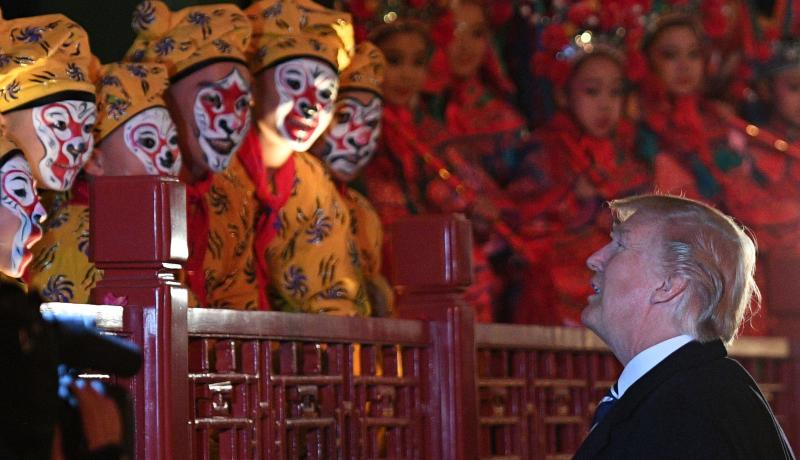 Donald Trump talks to opera performers at the Forbidden City during a visit to Beijing in November 2017. Photo: Getty Images.