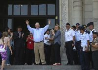 Peruvian President Pedro Pablo Kuczynski waves to government workers and supporters outside the House of Pizarro government palace and presidential residence, one day after offering his resignation in the capital, Lima. (Peruvian presidential press office/AP)
