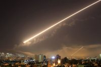 Damascus skies erupt with surface-to-air missile fire during the U.S.-led attack. (Hassan Ammar)