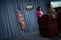 Chief spokeswoman Dana W. White, left, and Marine Lt. Gen. Kenneth F. McKenzie Jr. participate in a news briefing at the Pentagon. (Alex Wong)
