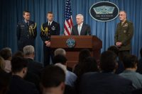Defense Secretary Jim Mattis, center, and Joint Chiefs of Staff Chairman Gen. Joseph F. Dunford Jr., right, brief reporters on the U.S. strike on Syria during a news conference at the Pentagon in Arlington. (Sgt. Amber Smith/Handout/Epa-Efe/Rex/Shutterstock)