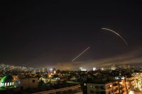 Missiles streak across the sky over Damascus as the United States launches an attack on Syria. (Hassan Ammar)