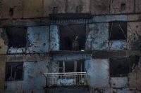 A Ukrainian fighter stands in a building damaged by shelling in Avdiivka, Ukraine, on Feb. 4, 2017. (Evgeniy Maloletka/AP)