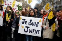 """A poster reading """"I am a Jew"""" during a demonstration in Paris last month after the killing of an 85-year-old Jewish woman.CreditThibault Camus/Associated Press"""