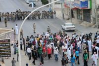 Police faced off against protesters in the town of Qatif, in eastern Saudi Arabia, in 2011. Crown Prince Mohammed bin Salman blames Iran for demonstrations by Shiite citizens in the oil-rich Eastern province.CreditReuters