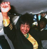 Winnie Madikizela-Mandela, the estranged wife of African National Congress leader Nelson Mandela, raises her fist as she arrives at a polling station in the east Johannesburg township of Katlehong to vote in South Africa's first elections by universal suffrage on April 27, 1994. (Harold Gess/AFP/Getty Images)