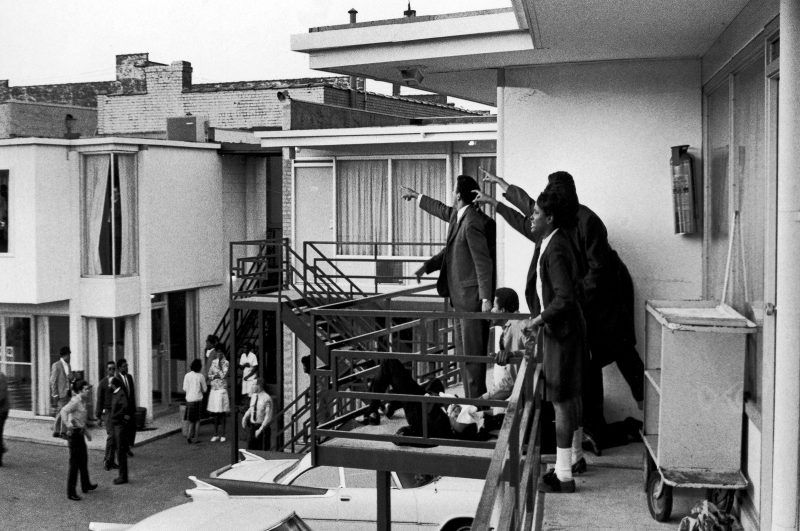 Dr. Ralph Abernathy (1929 - 1990) and Jesse Jackson (both obscured) and others stand on the balcony of Lorraine motel and point in the direction of gun shots that killed American civil rights leader Dr. Martin Luther King, Jr. (1929 - 1968), who lies at their feet, Memphis, Tennessee, April 4, 1968. (Photo by Joseph Louw/The LIFE Images Collection/Getty Images)