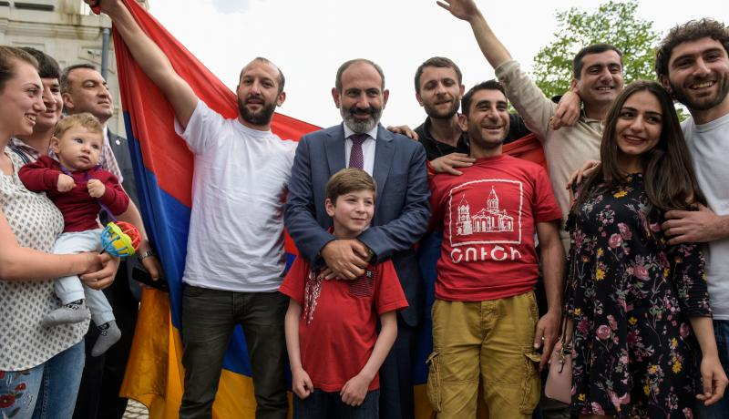 Armenian Prime Minister Nikol Pashinyan poses for pictures with locals during his visit to the disputed territory of Nagorny Karabakh on 9 May. Photo: Getty Images.