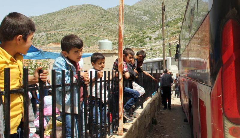Refugees in Shebaa, Lebanon wait to be returned to Syria on 18 April. Photo: Getty Images.