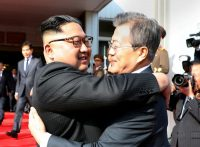 President Moon Jae-in of South Korea embracing North Korea's Kim Jong-un on Saturday, in a handout picture provided by the Presidential Blue House.CreditSouth Korea Presidential Blue House, via Reuters