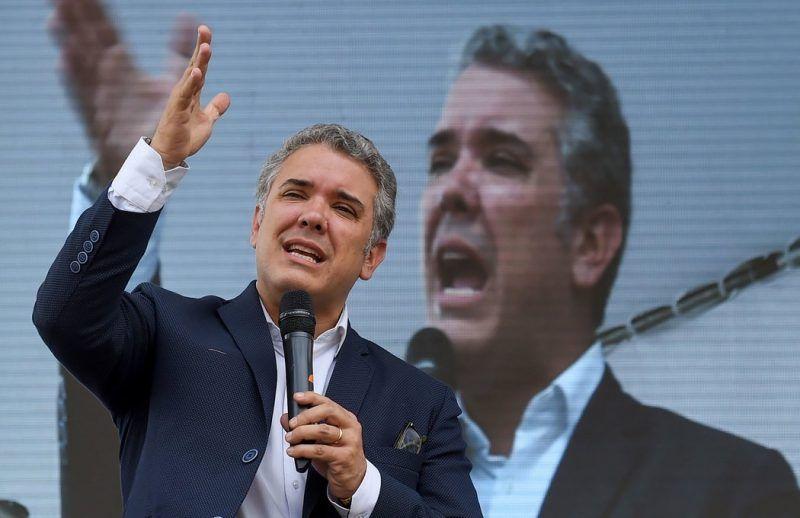 Iván Duque, candidato a la presidencia de Colombia, en una conferencia con el sector textil en Bogotá el 3 de mayo de 2018 Credit Raúl Arboleda/Agence France-Presse — Getty Images
