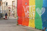 "A wall painted with the rainbow flag and the message ""Vote Yes!"" on Aug. 28, 2017, in Sydney, Australia, prior to a nationwide postal plebiscite on same-sex marriage. (Mark Kolbe/Getty)"