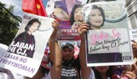 Hundreds marched in support of Chief Justice Maria Lourdes Sereno on May 11 in Manila. (Bullit Marquez/AP)