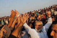 Ismail Haniyeh, the leader of Hamas's political wing, with protesters at Gaza's border fence with Israel on Tuesday. (Spencer Platt/Getty Images)