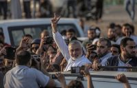Sheikh Ismaeil Haneiya of Hamas flashed the victory sign on Tuesday near the border with Israel in the east of the Gaza Strip. Scores of demonstrators had been killed by Israeli soldiers the day before.CreditMohammed Saber/European Pressphoto Agency, via Shutterstock