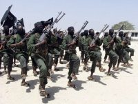 Hundreds of al-Shabab fighters perform military exercises in the Lafofe area south of Mogadishu, Somalia, in 2011. (AP)
