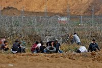 Palestinian demonstrators tried to pull down part of the fence on the Israel-Gaza border, east of the northern town of Jabalia, on April 27.CreditMohammed Abed/Agence France-Presse — Getty Images